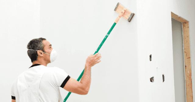 Man doing drywall repair